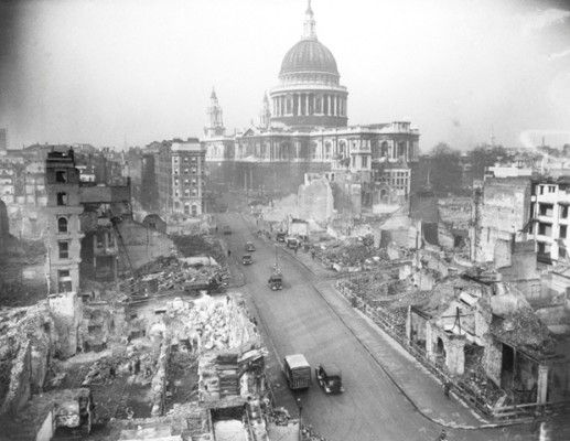 Original caption: 2/2/1942-London, England: With historic St. Paul's Cathedral- virtually unscathed -rising like a monument to the indomitable spirit of the city, the heart of London is still being tidied up after ceaseless German Air Raids, preparing for the new city that will rise when the war is over.  Photo shows Cannon Street, looking toward the cathedral, as demolition squads still labored. London, England