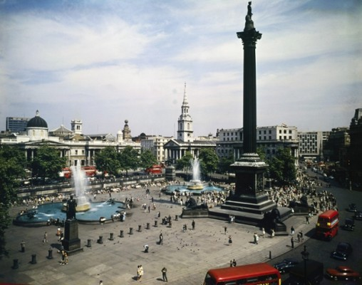 August 1961, London, England, UK --- London: Trafalgar Square: Left to right, National Gallery with dome, St. Martins-in-the-Fields, with spire, South Africa House, and The Strand. --- Image by © Bettmann/CORBIS