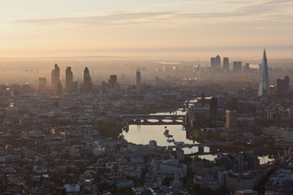 Photo by High Level Photography / Rex Features (1736603o) Aerial view of London skyline Aerial Views of London, Britain - 13 Jun 2012 These aerial photos offer a breathtaking bird's eye of London's world famous skyline. Taken at dawn as the city slowly woke, roads and pavements are eerily quiet - a very different scene to the usual hustle and bustle. With buildings stretching as far as the eye can seen, the images, which were taken from a helicopter, also show off the vast size of the city. Landmarks such as the Houses of Parliament, Buckingham Palace, Tower Bridge and the Albert Hall can all been seen. Meanwhile, some of the newer additions to the skyline - such as the London Eye and the Shard - are also shown. Of course, the newest construction to grace London is the Olympic Stadium in Stratford, which is currently being prepared for the grand opening ceremony. This ceremony, stage managed by director Danny Boyle, will feature a re-creation of England's green and pleasant pastures.
