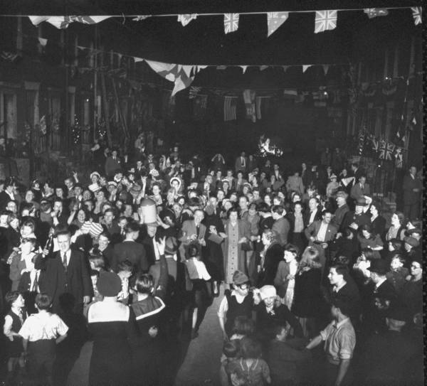 Revelers pack Lambeth Walk to celebrate VE Day, the end of WWII in Europe