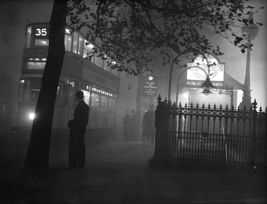 Old London Photo: A Tram Sails Through the Foggy London Night Outside Embankment Tube Station in 1938