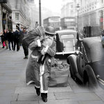 Father Christmas dons a tin hat during World War II as he makes his way down Regent Street on December 23rd 1940