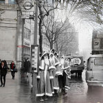 Young men dressed as Santa Claus wait for a bus in Holborn on December 1960
