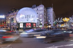 Photo: Eros Statue in Piccadilly Circus Covered in Snow Globe