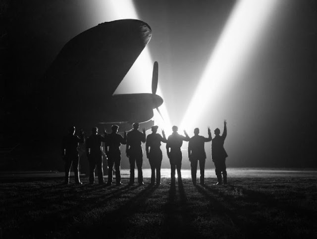 Ground staff at an RAF bomber station in Britain celebrate VE Day, 8 May 1945