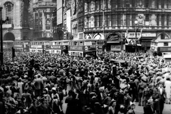 Crowds gathered in celebration at Piccadilly Circus, London during VE Day in 1945.