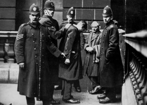 bobbies-arresting-man