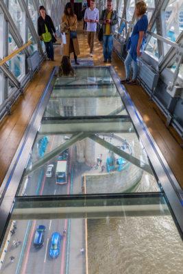 view from high-level walkway of Tower Bridge on the bridge traffic in London, UK